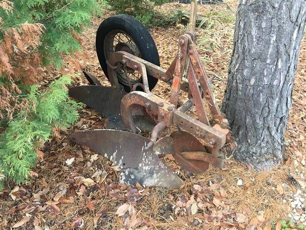 Picture of a Bantam branded tractor plow
