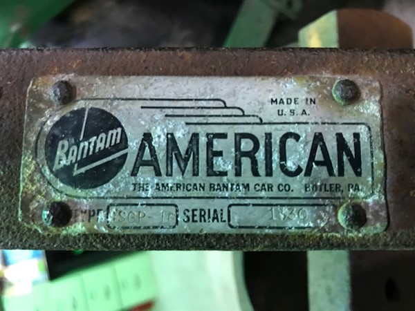 A metal tag with the American Bantam logo