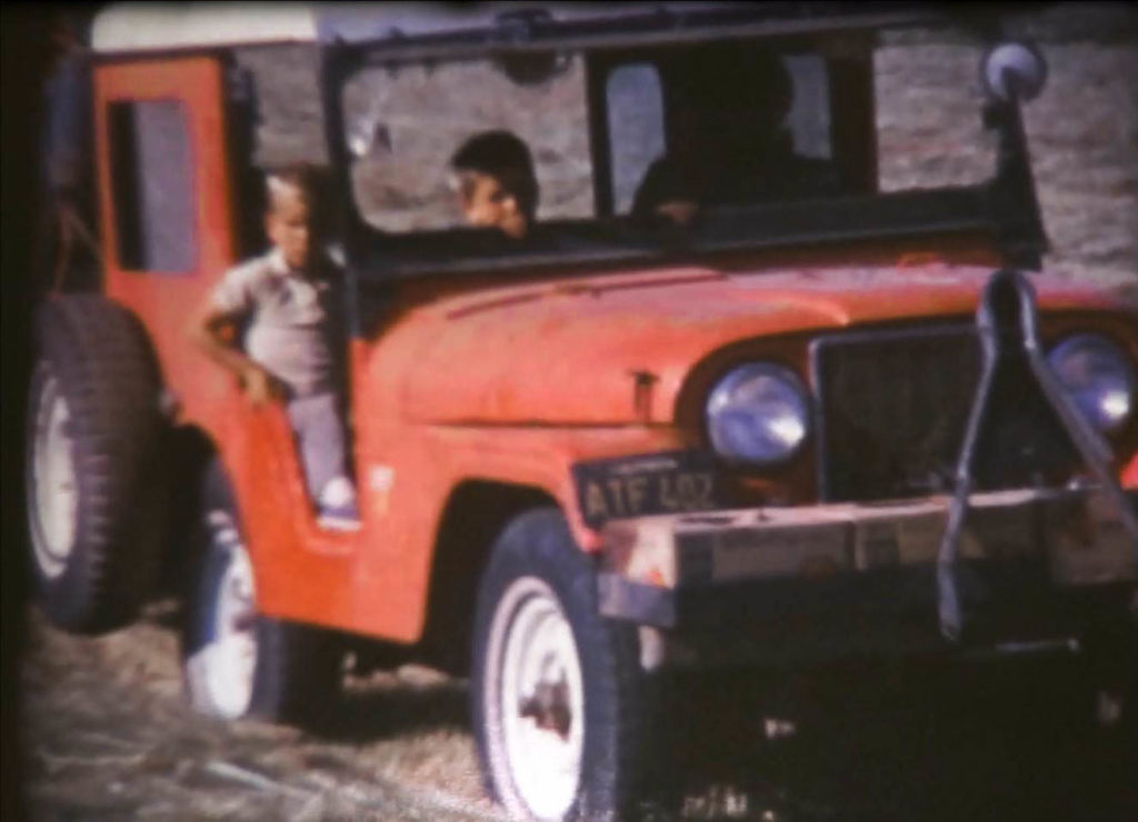 Jeep driven by women with two young boys