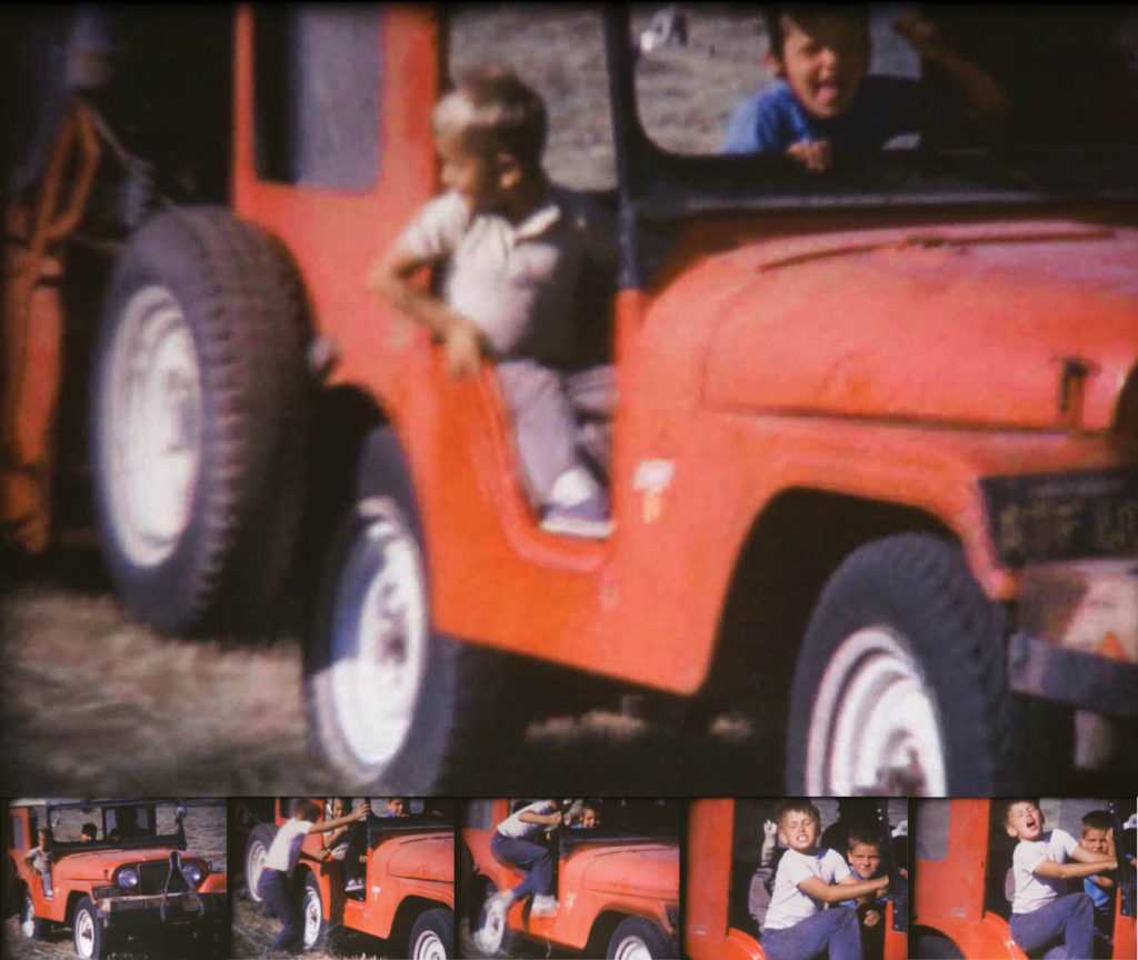 Yong boy jumps aboard a Jeep pulling a hay baler